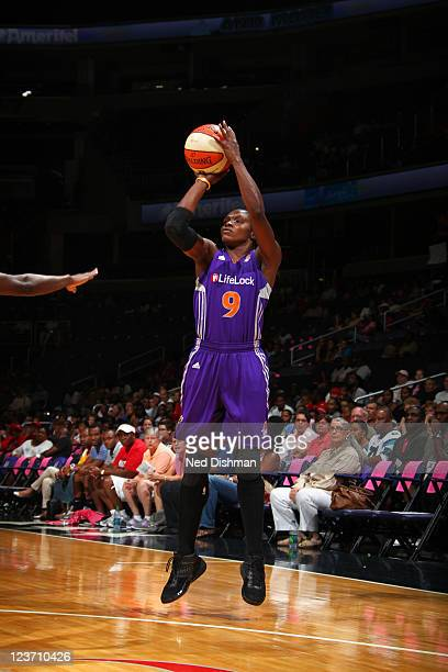 Marie FerdinandHarris of the Phoenix Mercury shoots the ball against the Washington Mystics at the Verizon Center on August 28 2011 in Washington DC...