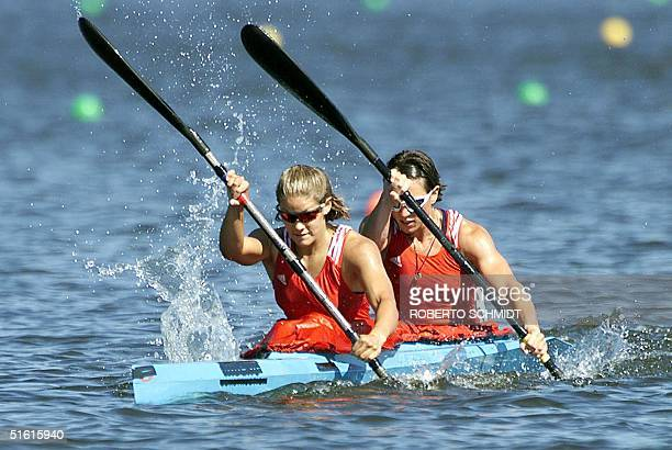 Marie GibeauOuimet and Carrie Lightbound head for a victory in the women's 500m doubles Kayak race on Lake Minnedosa during the XIII Pan Am Games in...