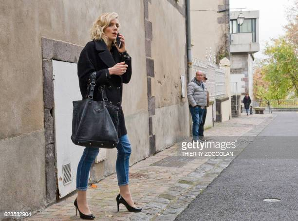 Marie Grimaud plaintiffs lawyer speaks on the phone on November 16 2016 outside the courthouse in Riom near ClermontFerrand central France during a...