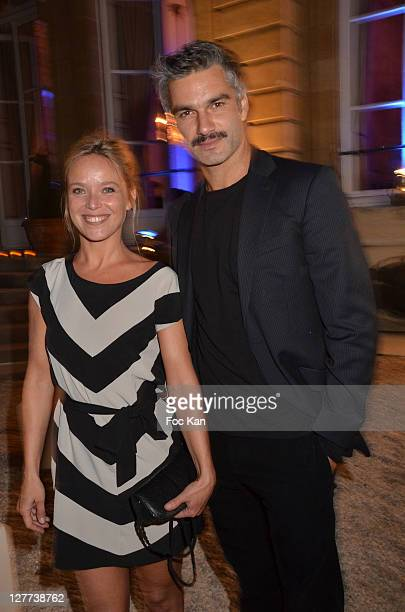 Marie Guillard and Francois Vincentelli attend the Peroni Nastro Azzuro Beer Cocktail Party at the Italian Embassy on September 29 2011 Paris France