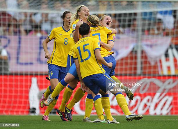Marie Hammarstrom of Sweden celebrates with team mates after scoring her goal during the FIFA Women's World Cup 3rd Place Playoff between Sweden and...