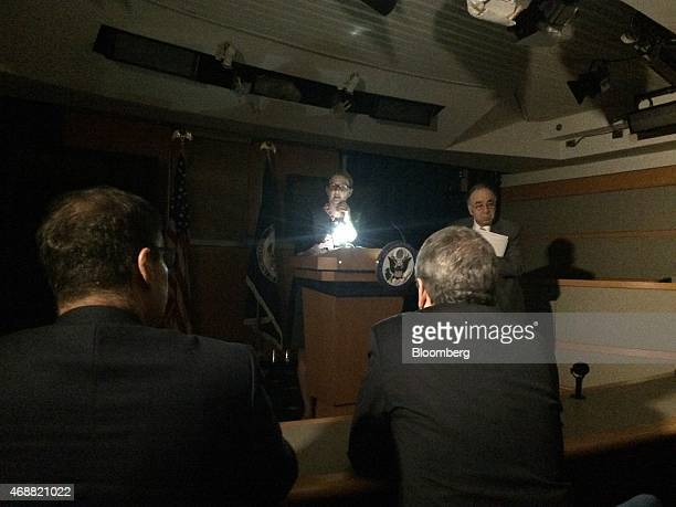 Marie Harf a spokeswoman with the State Department conducts the daily briefing for reporters using an iPhone to light her notes in Washington DC US...