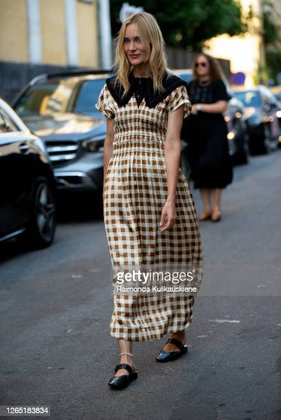 Marie Hindkær outside Ganni wearing withe and brown checked dress during Copenhagen fashion week SS21 on August 10, 2020 in Copenhagen, Denmark.