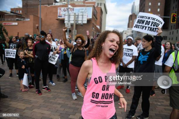 Marie Hudzinski a cousin of Antwon Rose II yells at an angry motorist at a protest a day after the funeral of Rose that blocked streets on June 26...