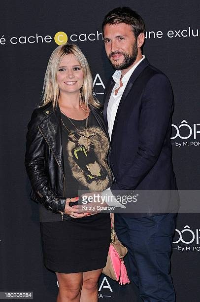 Marie Inbona and Alexandre Halimi attend the photocall for 'OORA' Womenswear Collection Designed By French Singer Matt Pokora at Pavillon Gabriel on...