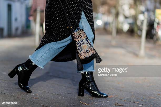 Marie Jaster wearing a black velvet Zara dress with long sleeves light blue denim jeans Levis black Zara heeld boots a black velvet bag HM trend on...
