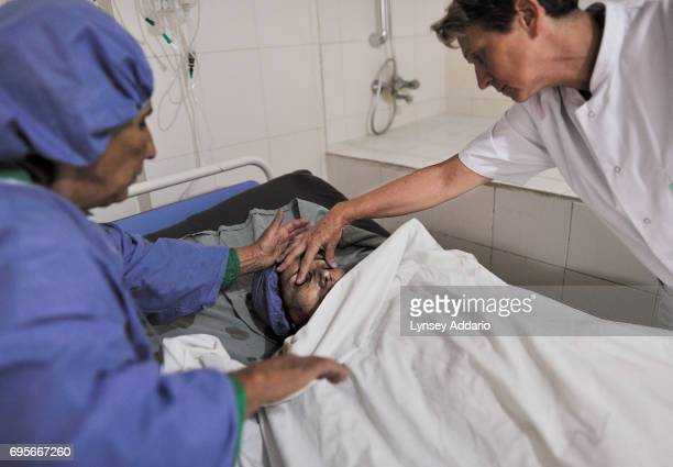 Marie Jose brunel a French nurse with the NGO Humaniterra closes the eyes of Gul Zada at the time of her death as her mother Zamarot looks on in the...