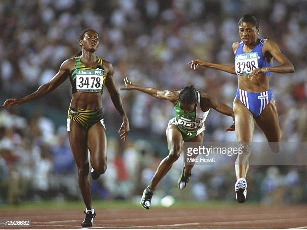 Marie Jose Perec of France wins gold in the womens 200 metres with Merlene Ottey of Jamaica #3478 second and Mary Onyali of Nigeria centre third in...