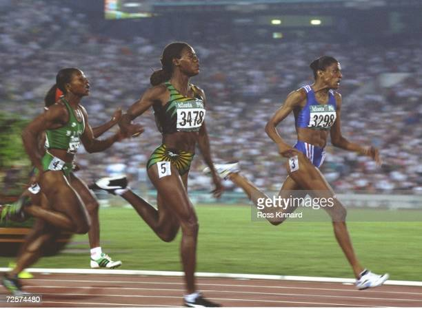 Marie Jose Perec of France wins the womens 200 metres with Merlene Ottey of Jamaica in second place for the silver in the Olympic Stadium at the 1996...