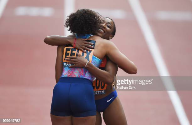 Marie Josee Ta Lou of Ivory Coast hugs Allyson Felix of the United States after winning the Women's 150m during the Great City Games on May 18, 2018...