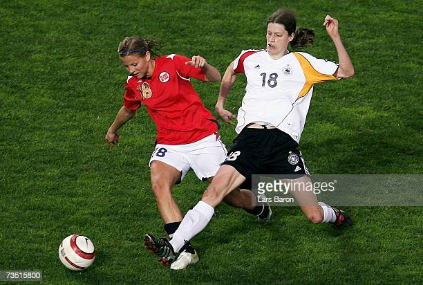 Marie Knutsen of Norway in action with Kerstin Garefrekes of Germany during the Algarve Cup match between Germany and Norway on March 7, 2007 in...