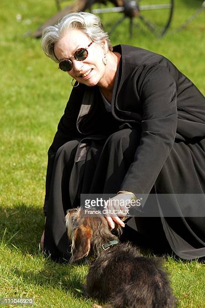 Marie Laforet actress and singer with her dog Herman in Valenciennes France on March 19th 2005