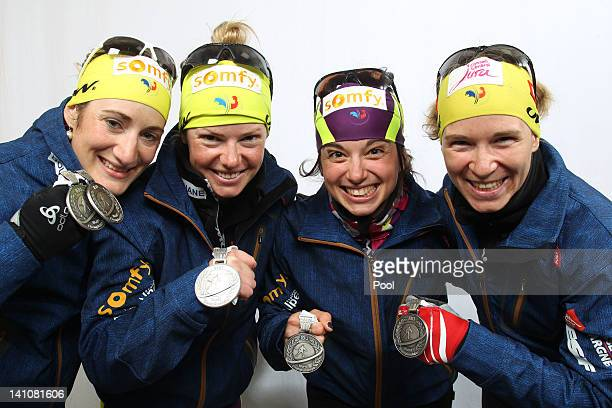 Marie Laure Brunet, Marie Dorin, Sofie Boilley and Anais Bescond of France show their medals of the Women's 4 x 6km Relay with her team mate Andrea...