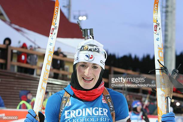 Marie Laure Brunet of France celebrates after the women's sprint in the EOn Ruhrgas IBU Biathlon World Cup on March 25 2010 in KhantyMansiysk Russia