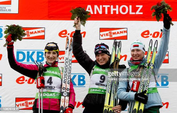 Marie Laure Brunet of France take 2nd place, Tora Berger of Norway takes 1st place, Darya Domracheva of Belarus takes 3rd place during the IBU World...