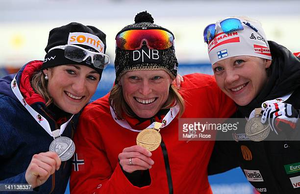 Marie Laure Brunet of France Tora Berger of Norway and Kaisa Maekaeraeinen of Finland celebrate their medals after the Women's 125km Mass Start...