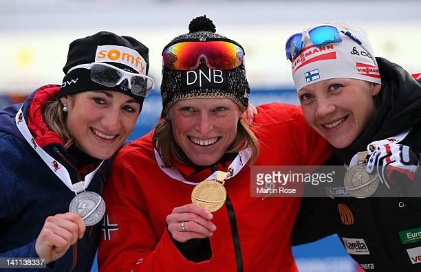 Marie Laure Brunet of France , Tora Berger of Norway and Kaisa Maekaeraeinen of Finland celebrate their medals after the Women's 12.5km Mass Start...
