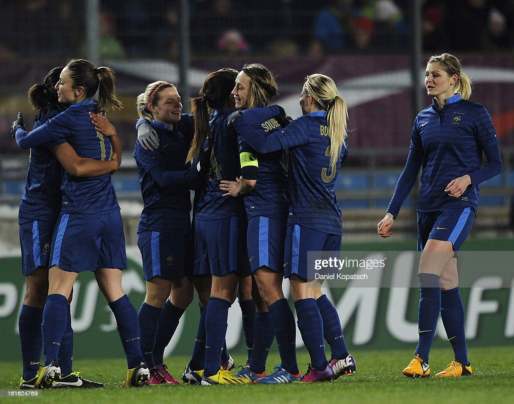 Marie Laure Delie of France (L) celebrates her team's third goal with team mates during the international friendly match between France and Germany at Stade de la Meinau on February 13, 2013 in Strasbourg, France.