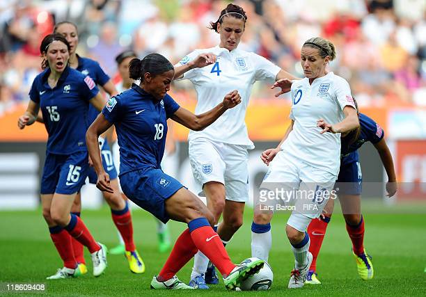 Marie Laure Delie of France challenges Jill Scott and Kelly Smith of England during the FIFA Women's World Cup 2011 Quarter Final match between...