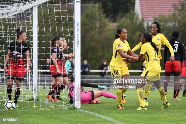 Marie laure Delie of PSG celebrates her goal with Marie Antoinette Katoto and Kadidiatou Diani during the women's Division 1 match between Fleury and...