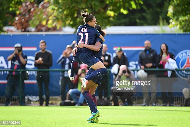 Marie Laure Delie of PSG celebrates with Veronica Boquete of PSG after she heads the only goal of the game during the women's French D1 league match...