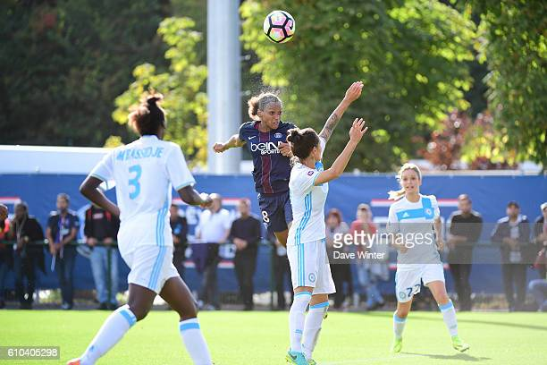 Marie Laure Delie of PSG out jumps Kelly Gadea of Marseille during the women's French D1 league match between PSG and Olympique de Marseille at Camp...