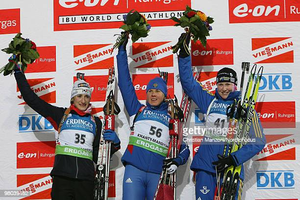 Marie Lauret Brunet of France Iana Romanova of Russia and Helena Jonsson of Sweden celebrate after the women's sprint in the EOn Ruhrgas IBU Biathlon...