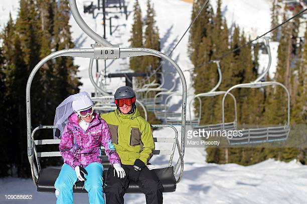 Marie Leslie of Charlotte NC is all smiles while riding the chair with her new husband Lance Christiansen at Loveland Ski Area after the 20th Annual...