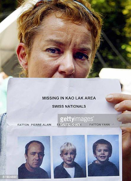 Marie Lise from Switzerland shows pictures of her missing brother and his two sons in Khao Lak 31 December 2004 The confirmed death toll in the...