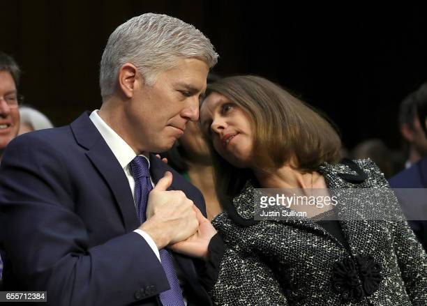 Marie Louise and Judge Neil Gorsuch embrace during the first day of his Supreme Court confirmation hearing before the Senate Judiciary Committee in...