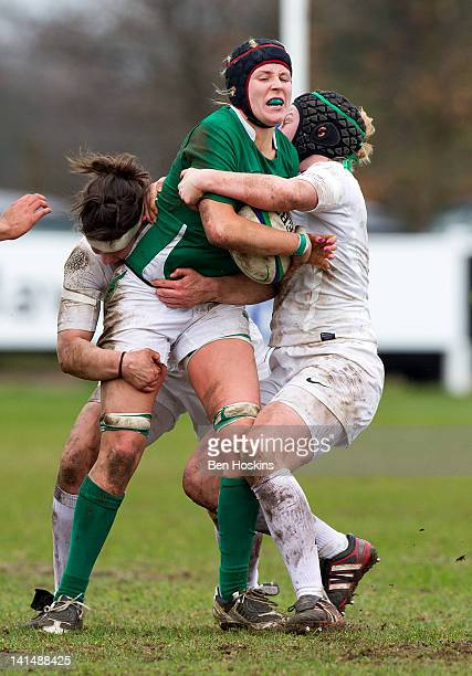 Marie Louise Reilly of Ireland is tackled by Rowena Burnfield and Marlie Packer of England during the Womens Six Nations match between England Women...