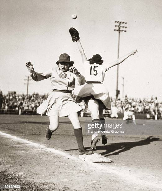 Marie Mahoney of the Racine Belles of the AllAmerican Girls Baseball League is safe at first in a game against the South Bend Blue Sox at Racine...