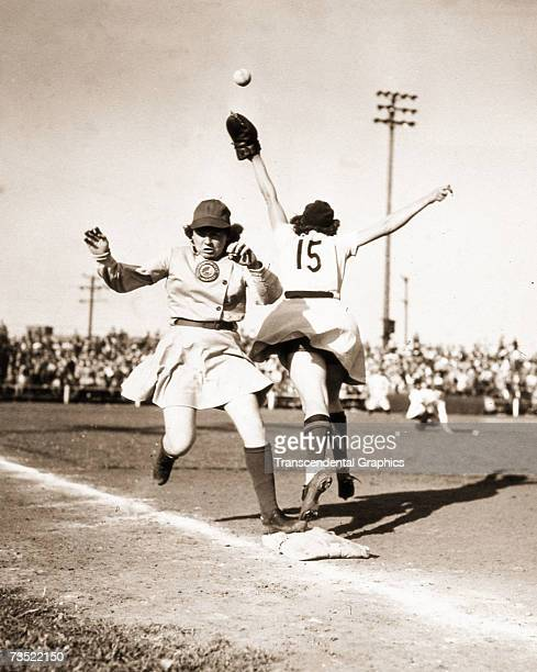 Marie Mahoney of the South Bend Blue Sox is safe at first as Margaret Danhauser first base reaches for a high throw during a game in 1947