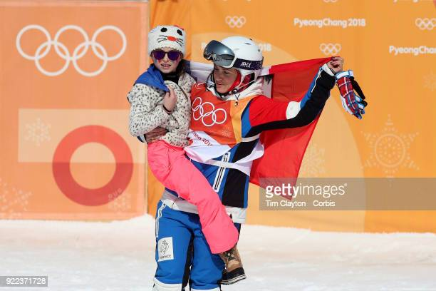 Marie Martinod of France after winning the silver medal celebrates with daughter Melirose during the Freestyle Skiing Ladies' Ski Halfpipe Final at...