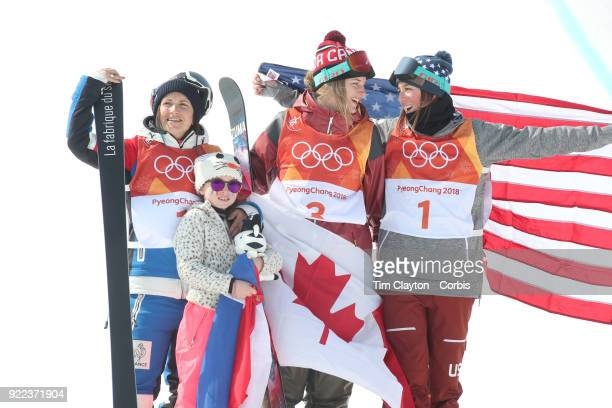 Marie Martinod of France after winning the silver medal celebrates with daughter Melirose along with gold medalist Cassie Sharpe of Canada and bronze...