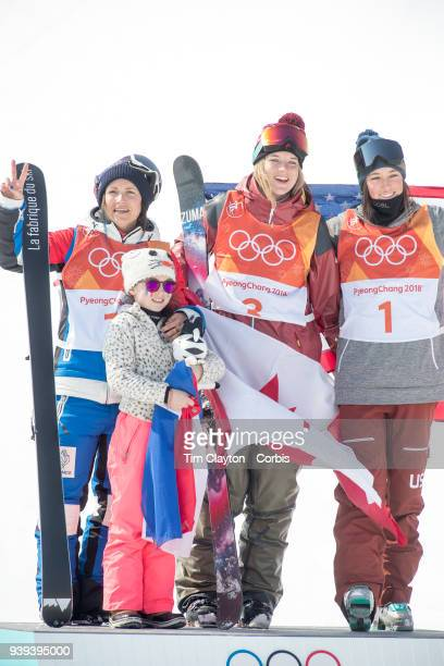 Marie Martinod of France after winning the silver medal celebrates with daughter Meli Rose along with gold medalist Cassie Sharpe of Canada and...