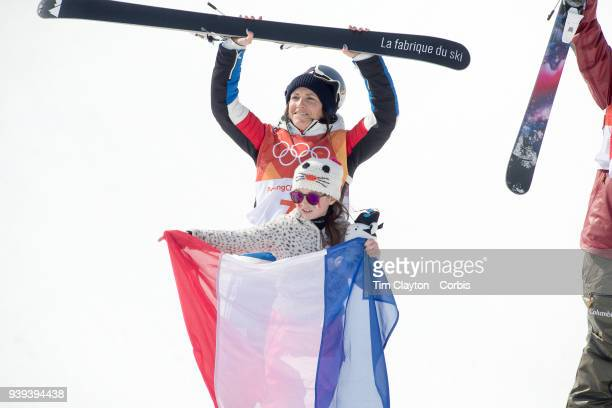 Marie Martinod of France after winning the silver medal on the podium with her daughter Meli Rose during the Freestyle Skiing Ladies' Ski Halfpipe...