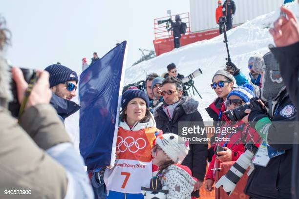 Marie Martinod of France after winning the silver medal with daughter Meli Rose during the Freestyle Skiing Ladies' Ski Halfpipe Final at Phoenix...