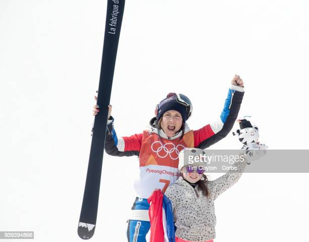 Marie Martinod of France celebrates after winning the silver medal on the podium with her daughter Meli Rose during the Freestyle Skiing Ladies' Ski...
