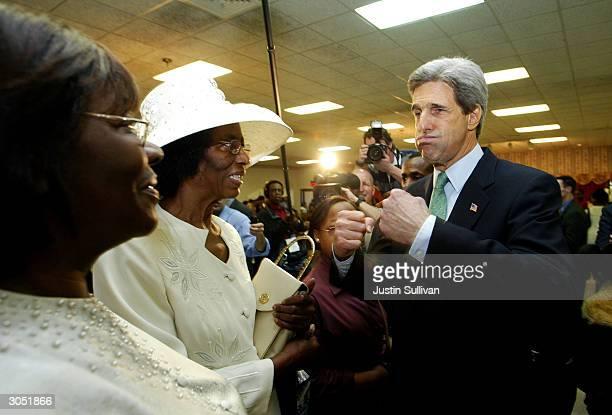 Marie McCray and Virginia Johnson of Jackson Mississippi greet democratic presidential hopeful and US Senator John Kerry at the Greater Bethlehem...