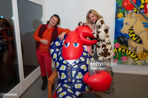 Marie Moatti and guest pose for photo during the Patricia Low Contemporary Exhibition Opening at Lobster Land Gstaad on February 17 2020 in Gstaad...