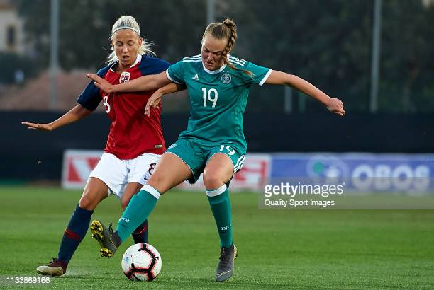 Marie Muller of Germany competes for the ball with Rikke Bogtveit Nygard of Norway during the 14 Nations Tournament match between U19 Women's Germany...