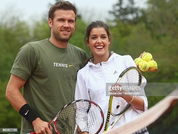 Marie Nasemann candidate of Germany's next Topmodel TV show plays a friendly match with Alexander Waske of Germany during day 2 of the BMW Open at...
