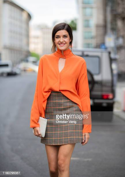 Marie Nasemann is seen wearing brown plaid skirt orange blouse outside Nobi Talai during Berlin Fashion Week on July 04 2019 in Berlin Germany