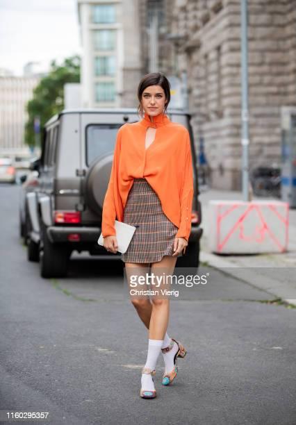 Marie Nasemann is seen wearing brown plaid skirt orange blouse white socks outside Nobi Talai during Berlin Fashion Week on July 04 2019 in Berlin...