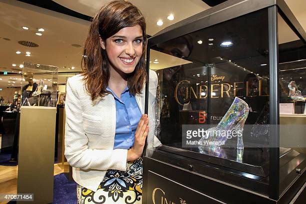 Marie Nasemann poses with a glass slipper during the Cinderella Exhibition presented by Breuninger Duesseldorf on April 22 2015 in Duesseldorf Germany
