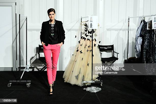 Marie Nasemann prepares backstage ahead of the Agne Kuzmickaite Igrida Zabere Kaetlin Kaljuvee Autumn/Winter 2013/14 fashion show during MercedesBenz...