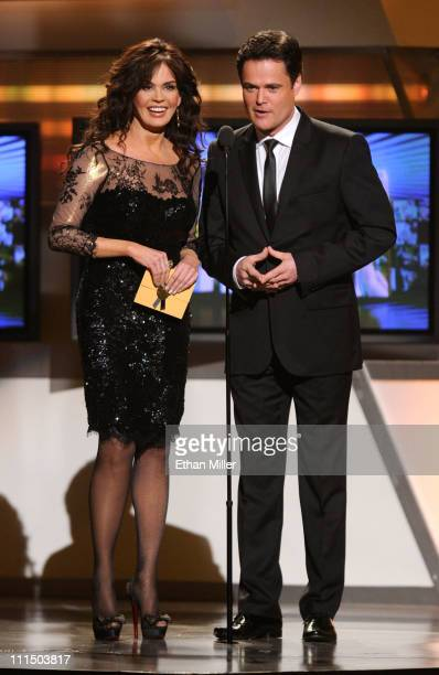 Marie Osmond and Donny Osmond speak onstage at the 46th Annual Academy of Country Music Awards held at the MGM Grand Garden Arena on April 3 2011 in...
