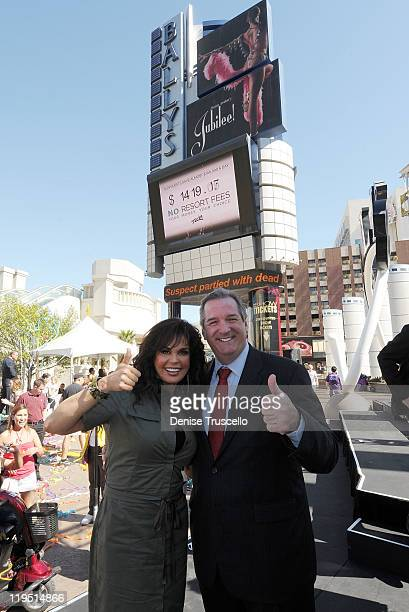Marie Osmond and President of Flamingo Resort and Casino Rick Mazer 'No Resort Fees' pose on the Las Vegas Strip on July 21 2011 in Las Vegas Nevada