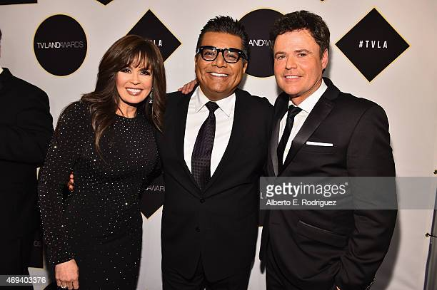 Marie Osmond comedian George Lopez and Donny Osmond pose backstage during the 2015 TV Land Awards at Saban Theatre on April 11 2015 in Beverly Hills...